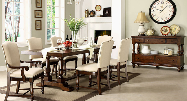 Dark wood dining set with white upholstered chairs and buffet